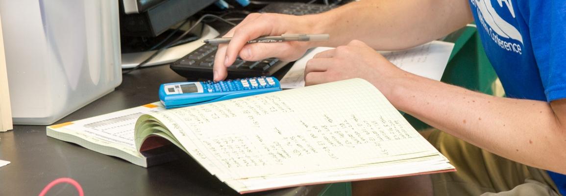 student using calculator